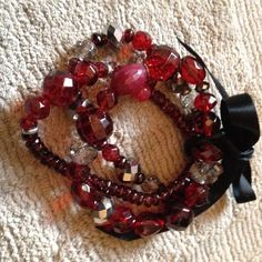 Red, Black and Silver Beaded Braclet New never worn. On elastic strand so one size fits all Jewelry Bracelets