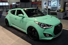 Hyundai Veloster in mint with black rims
