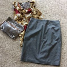 """Ann Taylor pencil skirt Gorgeous Ann Taylor pencil skirt. Gorgeous grey satiny feeling material. Hidden back zip and hook closure. Lined. Approx 22"""" long. 55 cotton 41 rayon 4 spandex. NWOT, never worn. Size 4. Ann Taylor Skirts"""