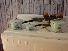 Dollhouse Miniature Shabby Chic Vintage Style Cookware with Pink Roses 4 Piece. $21.95, via Etsy.