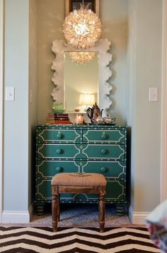 eclectic vignette - Mix of prints, textures, and neutrals with a pop of color