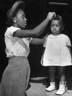 Mother Grooming Her Daughter For Healthiest Baby Contest Held at All African American Fair Premium Photographic Print by Alfred Eisenstaedt at Art.com