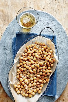 Crispy Parmesan Chickpeas Dry your chickpeas as thoroughly as possible before cooking to ensure a satisfyingly crisp result. If you're planning to pack these flavor-coated, fiber-filled poppers as a to-go snack, be sure to allow them to cool completely on Appetizer Recipes, Snack Recipes, Light Appetizers, Tailgating Recipes, Dip Recipes, Fall Recipes, Tapas, Healthy Snacks, Healthy Recipes