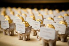 """Lucky Elephant"" Antique Ivory - Finish Tea Light Holder Cute elephant name cards with a little treat! Real South Asian Wedding: Archana Adrian Uhh ok I'm having an elephant themed wedding now. Wedding Table Seating, Wedding Favor Table, Wedding Table Names, Wedding Centerpieces, Wedding Decorations, Wedding Reception, Reception Seating, Wedding Themes, Table Decorations"