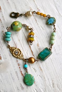 Evelyn...  was a romantic beauty...  features assorted vintage glass beads and czech glass beads,vintage rhinestone charm,vintage faux glass