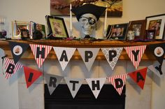 """Mantle decor for a pirate birthday party. Black mesh torn up and """"treasure"""" placed at random!!"""