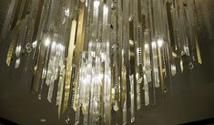 Sculptural Installations - Rothschild & Bickers - laser cut brass sheet used for decorative elements on chandelier