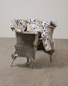"Olga Koumoundouros, ""Hogtie"", 2011, Wicker loveseat, paper mache of high interest loan papers and Martha Stewart magazine images, 39"" x 42"" x 33"""
