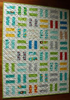 Modern Baby Quilt for Boy or Girl in Moda Bungle Jungle Fabrics with White, featuring Animals in Rail Fence Pattern