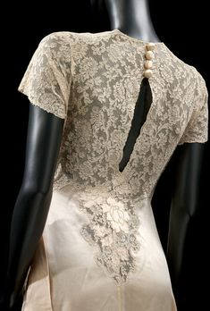 Dressing Gown - France - 1932. From the Victoria & Albert Museum. Completely hand stitched using Valenciennes lace (a type of bobbin lace) which is dyed to match the silk.