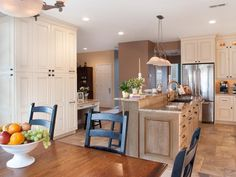 A large cabinet with added storage for everything from cleaning supplies to dry goods was created to maximize space in this understated country kitchen.