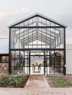In winter, the conservatory is configured to enable solar gain while keeping cold air out. Photo 6 of 18 in A South African Architect Designs an Off-Grid, Modern Home For Her Parents Contemporary Architecture, Interior Architecture, Sustainable Architecture, Architecture Supplies, Environmental Architecture, Ancient Architecture, Landscape Architecture, Conservatory House, Modern Conservatory