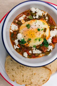 Shakshuka, eggs cooked in a mildly spicy tomato sauce, is a great one pot vegetarian camping breakfast or dinner!