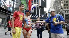 """¿Quiénes son las """"desnudas"""" que posan con los turistas en Times Square"""