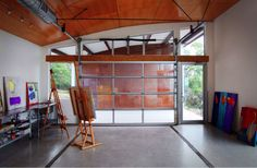 A drab garage can be transformed into an inviting artist's studio by adding natural light. Whether that means raising the door or upgrading to glass walls, there is a solution at every budget.