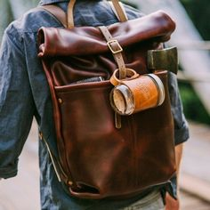 """The handsome, yet highly functional,Ruck Sack by Loyal Stricklin is crafted in a rich horween leather and features a large opening to hold all your essentials. One large opening with two smaller pockets on the front. Made of 4-ounce Tan Horween Chromexcel with 9 ounce Natural Chromexcel straps. 12 """" wide x 5"""" deep x 19"""" tall (rolled up), extends to 25"""" tall when unrolled. Please allow 2-3 weeks for shipping."""