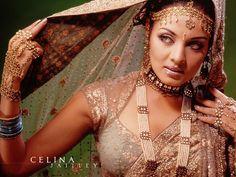 Free Indian girl wallpaper  http://www.freegreatpicture.com/indian-beauty/indian-beauty-wallpapers-4928