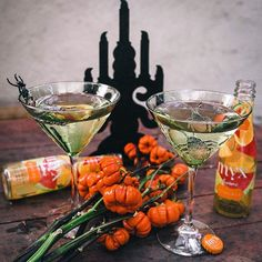 MYX O'Lantern Cocktail!  The best thing about MYX Sangria? It's already the perfect drink. We poured our Tropical Sangria into martini glasses and added some creepy crawlers as garnish. Perfect for Halloween!