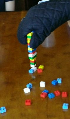 """Lego Party - For the game, we played as """"mini-figures"""" to see who could build the tallest stack of Lego bricks with mini-figure hands (oven mits). This ended up being the winning strategy."""