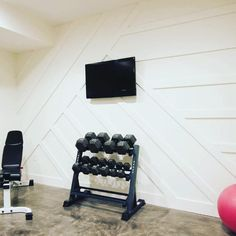 If you've seen the exterior of our house, you know that we've used quite a bit of board and batten. Why not bring that inside and give it a modern twist? In this article, I'll show you how I created our modern board and batten accent wall. Installing Wainscoting, Wainscoting Wall, Ship Lap Walls, Workout Rooms, Wall Treatments, Porch Swing, Porch Bed, My New Room, Diy Wall