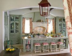 so french; love the built in shelves for recipe books and the back splash behind the stove