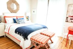 Rosa Beltran Design {Blog} Larchmont Bungalow home house Tour Guest Bedroom coral orange and cobalt blue bedroom x bench x-benches x-bench benches foot of bed octoganal woven mirror above bed octagon thrift store antique flea market DIY before & and after serena and lily gobi bedding ginger jar lamps oriental asian navy blue orange desk benjamin moore pinata white windsor chair hanging umbrellas in street print greek key trim on ikea aina curtains