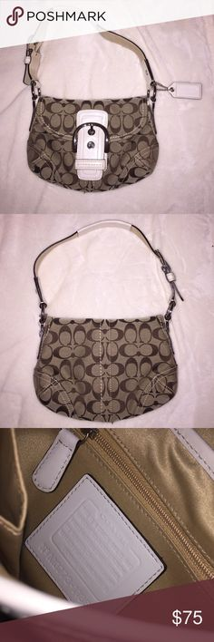 Coach Handbag Authentic Coach handbag. Can be worn on shoulder or simply held in hand. Colors are tan and white. Small stain inside bag (most likely a make-up stain & also shown in picture) Coach Bags Shoulder Bags