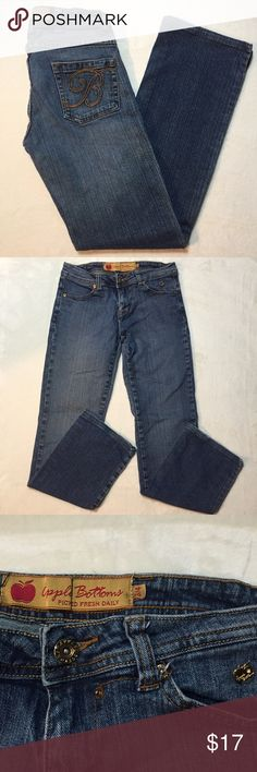 """Apple Bottom Jeans Bootcut Denim Apple Bottom Jeans Bootcut Denim  These jeans are in fair condition. The """"A"""" and """"B"""" are embroidered on the back pockets, and there is a gold logo on the left hip. The right pant leg shows some discoloration. There is some fraying at the hems. These have been hemmed, so please refer to measurements.  Approximate measurements: Total length - 35 3/4"""" Inseam - 29"""" Rise - 7 1/2"""" Across the top - 13 1/2"""" Hips - 15 1/4""""  ⭐️bundle with other items to make the most…"""