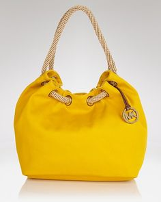 Michael Kors tote... Almost bought this at Dillard's. I love yellow bags. I need one.