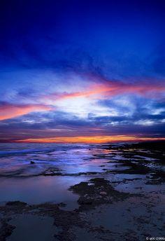 Puesta de Sol en la playa de Las Murallas en El Puerto de Santa María, Cádiz, España. Sunset in Las Murallas Beach, El Puerto de Santa María, Cádiz, Spain.