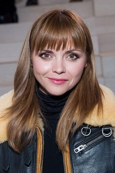 Christina Ricci with blunt bangs, metallic smokey eyes and fuchsia stained lips on September 15.