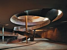 Antinori Winery Bargino. Winding its way four times about the central column with different radii, the staircase has an overall length of 100 m. Made up of 35 elements that were welded together on site. The 17-metre-high 105-tonne Corten-steel staircase is fixed only at the foot to the roof terrace and to the column at three points along its length. A free-standing structure with a light, sweeping appearance it invites people to climb its 118 steps in order to enjoy the broad view of the…
