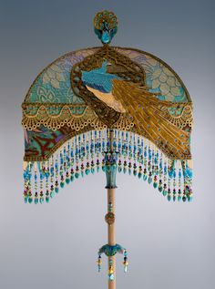 Detail of Peacock Lamp....LADIES AND GENTLEMAN,INTRODUCING THE MAIN ACT....THE PEACOCK EMBELLISHED LAMPSHADE LIVE & UP CLOSE. BREATHTAKING!!!!! THIS PEACOCK FLOOR LAMP AND LAMPSHADE IS A MUST FOR YOUR PEACOCK DECOR AND OR PEACOCK COLOR SCHEMED DECOR. YOULL GET AN ENCORE FROM YOUR GUESTS WITH THIS WOW FACTOR MAKING A GRAN STATEMENT. I BELIEVE THIS PEACOCK LAMP AND LAMPSHADE DESERVES AN ENCORE. ITLL GIVE YOU AL LONG ENCORE PERFORMANCE IN YOUR BEAUTIFUL PEACOCK DECORED ROOM...CHERIE