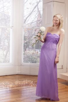 Elizabeth Merlin, a bespoke wedding dress designer can create unique bridesmaids' dresses. This is 'Sylvie,' a chiffon dress with ruched bodice. For more details, visit www.elizabethmerlin.co.uk
