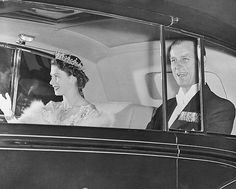 Britain's Princess Elizabeth wears a jeweled tiara and necklace in photo from May of 1951 in London. The royal couple are arriving at Buckingham Palace from Clarence House for an official banquet in honor of the King and Queen of Denmark given by her parents, King George VI and Queen Elizabeth. The princess, who was 25 in April, is a busy woman. Now, with her father ill and weak, she must take over many of the burdens of the sovereign, too. (AP Photo)