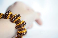 Comfortable and flexible bracelet, handbeaded by me choosing chocolate brown and honey yellow colors, it makes me think in a little bee, the sweet