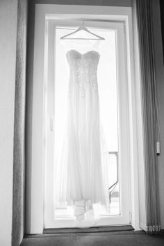 Summertime weddings are so romantic and soft. A beautiful wedding dress back that flows just like the winds of summertime. Beautiful greenery , romantic hairstyle, and an elegant lace wedding dress makes an absolutely great photograph!