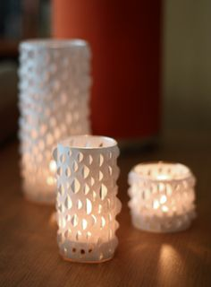 This paper light is made as a cylinder that has been cut out with various-sized holes to form a pattern around the paper - however, the picture shows it being used for a tea candle, which could bring up a fire hazard when in use. I would change this by using electric lights instead of a naked flame.