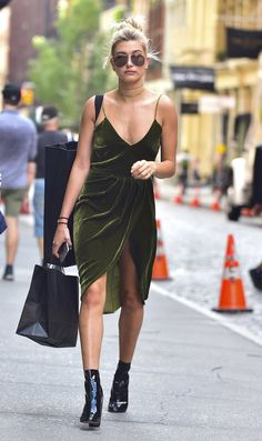 Pin for Later: Kendall and Hailey Are Already Wearing This Fall 2016 Trend Like No Big Deal Hailey Baldwin Hailey gives her nod of approval to the Fall velvet trend by slipping into this deep-cut emerald dress while out in NYC.