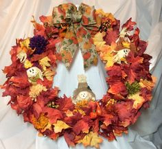 "Fall scarecrow wreath. Maple leaves and  mums on 18"" grapevine form, stuffed scarecrows.. Pumpkin print bow. Fall colors. Chenille hanger. by KhQualityCreations on Etsy"
