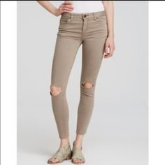 🌟SALE🌟OFFER $32 🌟 Free People skinny jeans Free People jeans size 30 in Steel. Sold out color in many locations. I think these are more of a brownish-gray.  Ankle length stretch denim with holes at the knees. Five pocket style; zip fly with button closure. Free People Jeans Ankle & Cropped