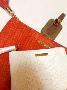 Bright pouches are perfect for the summer, along with a Renaissance Ring to match the two. For pouches $55 each: http://www.desiresbymikolay.com/products/gigi-new-york-leather-zip-pouch. For Scott Mikolay ring $3995: http://www.desiresbymikolay.com/collections/scott-mikolay-ring/products/scott-mikolay-everyday-cocktail-ring-rose-gold