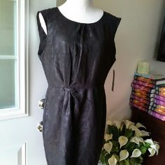 DKNY JEANS BLACK DRESS Soft material look like leather. Sleeveless with back zipper.  Very trendy and stylish.  Charcoal black. DKNY Dresses Mini