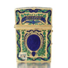 A GOLD AND ENAMEL CARNET DE BAL, GENEVA,LATE 18TH CENTURY engraved 'Souvenir/ d'amitie' within dark blue and emerald green champlevé enamel leaves, scrolls and ribbons, the interior complete with gold-pinned ivory tablet and gold-mounted pencil.