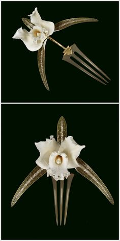 "René Lalique (French, 1860-1945) - This orchid comb is carved from a single piece of ivory and is set on a gold stem striped with brown enamel. Three leaves extend from the base of the blossom rendered in ""plique-à-jour"" enamel graduated in hue from delicate peach to pale olive. The central vein of each leaf begins with a short section of light grey enamel and is followed by a row of graduated diamonds   1903-1904. 