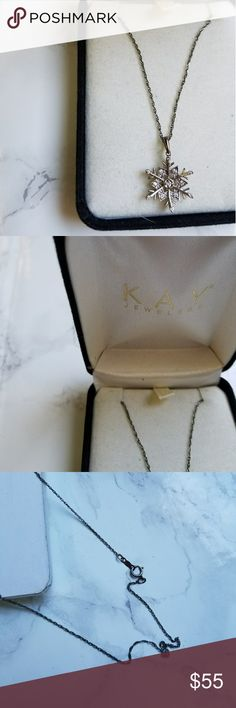 Kay jewelers white gold snow flake necklace Kay jeweler's snow flake necklace - 14k white gold diamond chipped. Very pretty - and delicate piece. Worn once Kay Jewelers Jewelry Necklaces