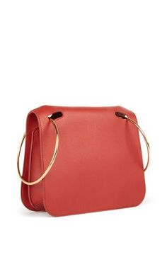 This **Roksanda** bag is rendered in leather and features a boxy silhouette and a top handle.