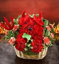 How cute!! A flower arrangement shaped like a devil dog for Halloween.