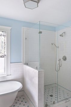 Using tile wainscoting as opposed to beadboard in the bathroom is a great way to protect the integrity of the bathroom walls and complement the tile lining the shower.