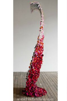 This is fine art and abstract art in the form of contemporary sculpture. Bed of Roses. Flowers, steel rods, steel plate, aluminum sheet, ink jet print with archival inks on canvas, silk rose petals, acrylic medium. Tall standing sculpture covered on the back with rose petals. Side view. One can stand leaning into the sculpture. You can relax on this Bed of Roses! www.nikiketchman.com #NikiKetchmanFineArt